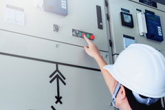 Women engineer working on checking and maintenance electrical equipment. Women engineer checking status switchgear with checklist royalty free stock photo