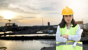 Women Engineering wearing hard hat and working at construction site royalty free stock photo