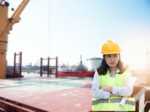 Women Engineering wearing hard hat and working at construction stock photography