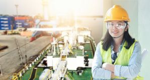 Women Engineering wearing yellow helmet at construct royalty free stock photo