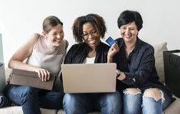 Women enjoy shopping online with credit card stock image
