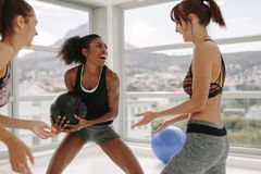 Women enjoying exercising with medicine ball at gym Royalty Free Stock Photos