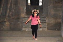 Women enjoying holiday in Elephanta cave Mumbai India. stock photos