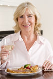 Women Enjoying meal,mealtime With A Glass Of Wine Stock Photos