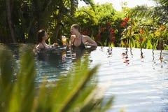 Women Enjoying In Outdoor Swimming Pool Royalty Free Stock Photos