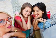 Women Enjoying Shopping Day. Beautiful women with shopping bags in the city for a shopping Royalty Free Stock Photos