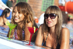 Women enjoying in swimming pool Royalty Free Stock Photo