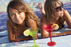 Women enjoying in swimming pool Royalty Free Stock Photo