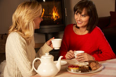 Women Enjoying Tea And Cake Together. Two Middle Aged Women Enjoying Tea And Cake Together Stock Photo