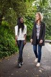 Women enjoying walk in park stock photo