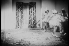 Women enter living room and practice dance routine stock footage