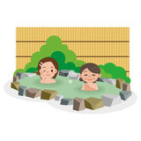Women entering the hot spring Stock Photo