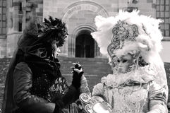 Women in epoch costumes holding hands. Black and white image with two women dressed in Renaissance costumes, playing the role of countesses or maybe duchesses Stock Photo