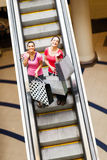 Women on escalator Stock Photo