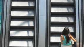 Women on the escalator stock video