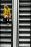 Women on Escalators Royalty Free Stock Photos