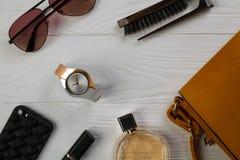 Women essentials fashion accessories on white wooden background. Women essentials fashion accessories on white background Royalty Free Stock Images