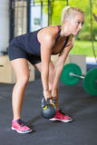 Women exercise with kettlebell in fitness gym Stock Photos