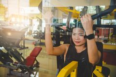 Women exercise in a professional gym with a selection of exerci. Se equipment royalty free stock photography