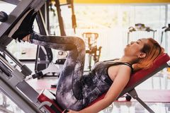 Women exercise in a professional gym with a selection of exerci. Se equipment royalty free stock photos