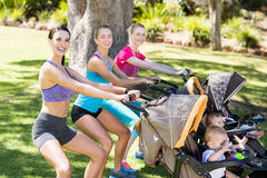 Women exercising with baby stroller Royalty Free Stock Images