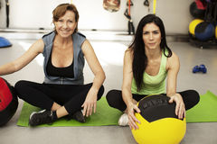 Women exercising with balls. In fitness center royalty free stock photo