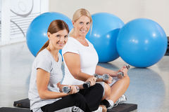 Women exercising with dumbbells Stock Images