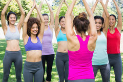 Women exercising with female instructor at park Royalty Free Stock Photos