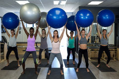 Women exercising with fitness ball Stock Photo
