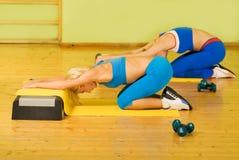 Women exercising in fitness club Stock Photo