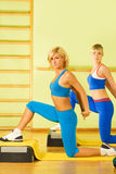 Women exercising in fitness club Stock Photo