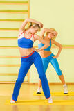 Women exercising in fitness club. Beautiful women exercising in fitness club Royalty Free Stock Photos