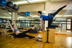 Women exercising in gym. Determined women exercising in gym Stock Photos