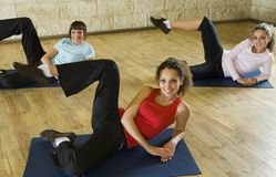 Women exercising on mat Royalty Free Stock Photo