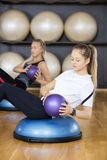 Women Exercising With Medicine Ball Stock Images