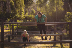 Women exercising on outdoor equipment during obstacle course stock photography