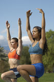 Women Exercising In Park Royalty Free Stock Image