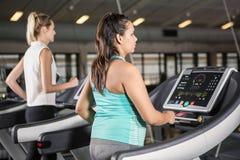 Women exercising on treadmill Royalty Free Stock Photo