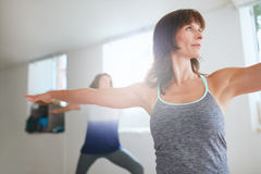 Women exercising at yoga class. Royalty Free Stock Images