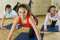 Women exercising on yoga mat Royalty Free Stock Photography