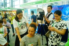 Shenzhen, China: health care exhibition, aromatherapy acupuncture and moxibustion. Women are experiencing the efficacy of aromatherapy in Shenzhen health care royalty free stock photo