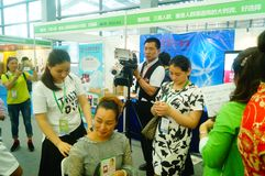 Shenzhen, China: health care exhibition, aromatherapy acupuncture and moxibustion. Women are experiencing the efficacy of aromatherapy in Shenzhen health care royalty free stock photography
