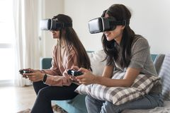 Women experiencing virtual reality with VR headset Royalty Free Stock Image