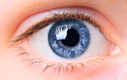 Women eye. Close-up, painted blue Stock Photos