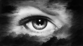 Women eye painting in cloud sky effect black and white retro sty Royalty Free Stock Image