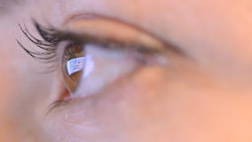 Women eye with reflection of surfing internet at night Stock Photos