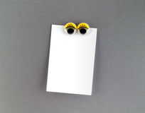 Women eyes fridge magnet and blank note for text input Stock Images