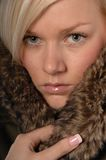 Woman in fake fur Stock Photography