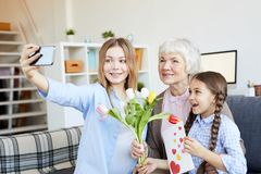 Women in Family Taking Selfie royalty free stock images