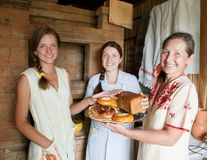 Women with  farm-style meal Stock Image